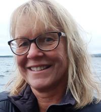 porträtt på Carina Ahlstedt, doktorand vid Uppsala universitet.