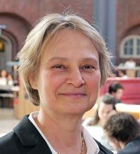 Ansiktsporträtt Linda Rose, tema badrum och belastningsskador.